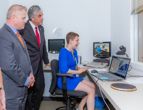 Graduate student Kate Witham demonstrates technologies to ACL Administrator Lance Robertson and HHS Deputy Secretary Eric Hargan.