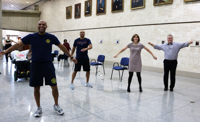 VADM Adams, Robertson, and Lazare participating in Zumba